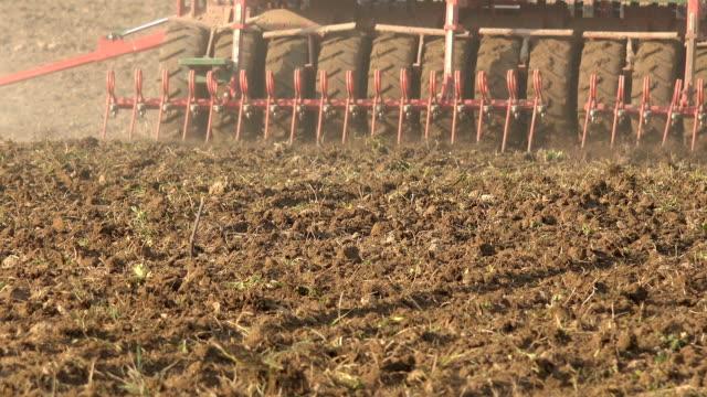 Complex sower seeder equipment cultivate sow crops in fertile soil. Closeup. video