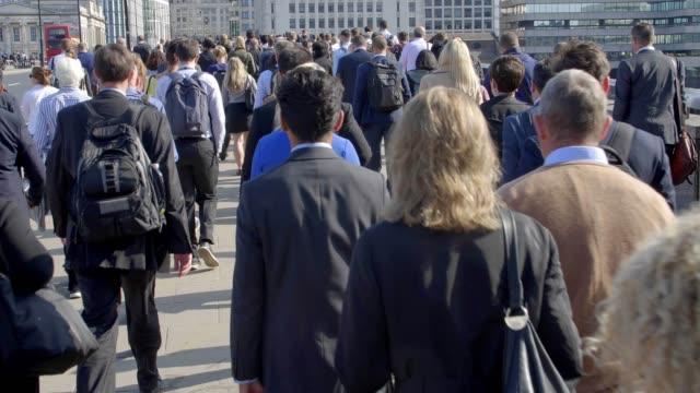 composite, commuters walking to work, three angles. - время дня стоковые видео и кадры b-roll