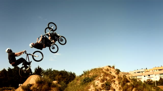 HD SLOW MOTION: Composite Shot Of A Backflipping Dirt Jump video