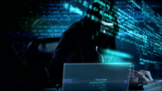 Composite video of hacker using laptop Composite video of hacker using laptop with data on background hacker stock videos & royalty-free footage