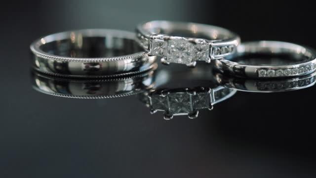 vídeos de stock e filmes b-roll de composition of two wedding rings and engagement ring. - três objetos