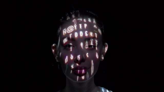 Computer characters projected on a woman's face