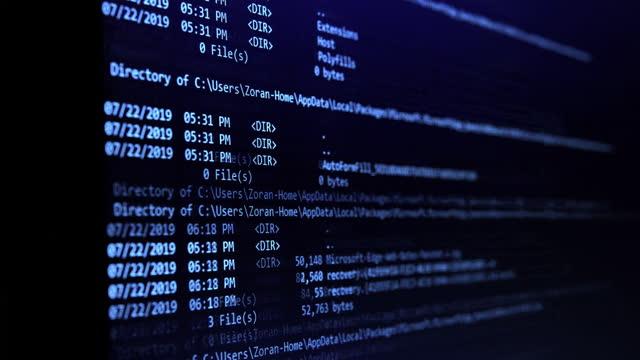 Computer code on a screen erasing data, representing a computer virus / malware attack