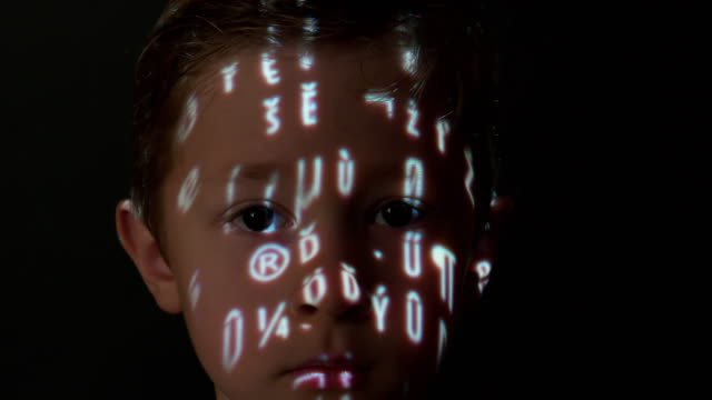 Computer data projection on a boy's face
