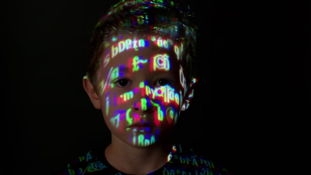 Computer data projection on a boy's face video