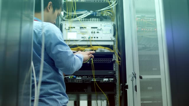 computer engineer checking on site - supporto tecnico video stock e b–roll