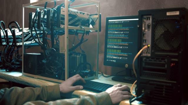 Computer hacker programming at computer, real time