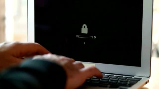 Computer hacker stealing data from a laptop video