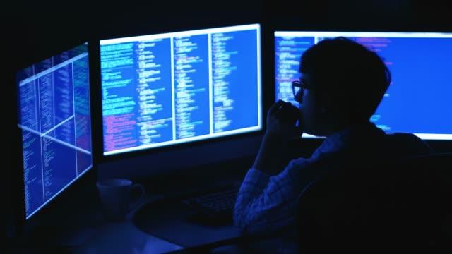computer programmer coding an advance system - безопасность сети стоковые видео и кадры b-roll