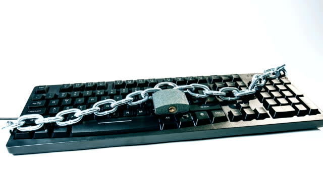 Computer protection inspiration, metal chain and locked padlock video