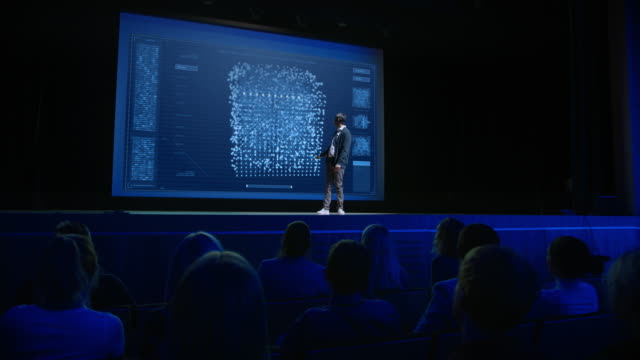 Computer Science Startup Conference: On Stage Speaker Presents New Product, Talks about Neural Networks, Shows Artificial Intelligence App on Big Screen. Video with Vertical Screen Orientation 9:16 video