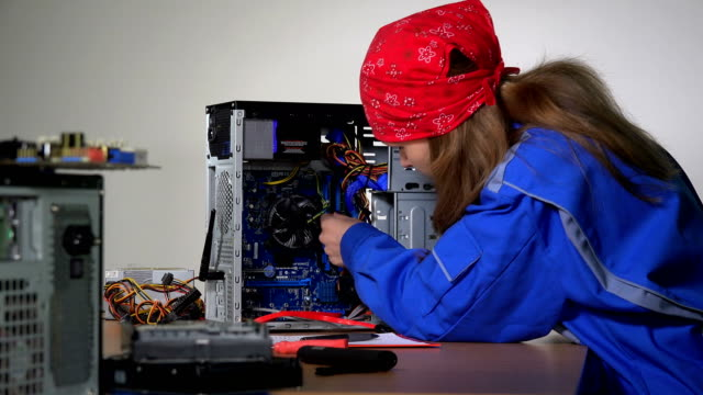 computer service specialist woman remove and examine ram memory plate