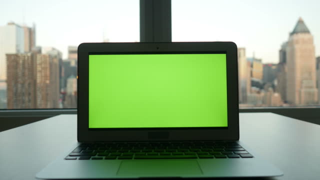 Computer with Greenscreen in Modern Office Building with Cityscape Background. video