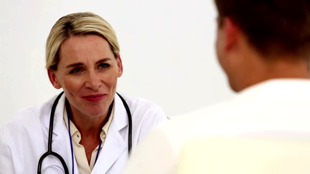 Concentrated female doctor listening to her patient video