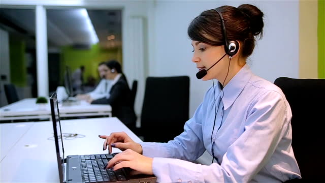 Concentrated operator answering a call in office video