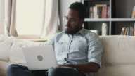 istock Concentrated young african ethnicity man checking web surfing information online. 1220336428
