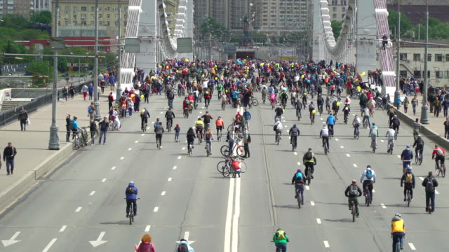 Concept bike and a healthy lifestyle. Tens of thousands of people on Bicycle parade. Aerial view video