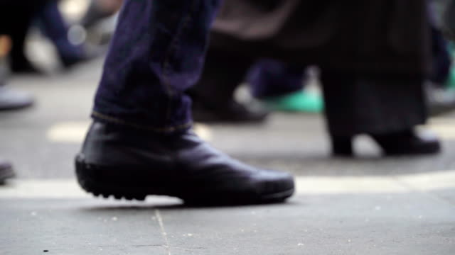 Concept crowd feet with shoes closeup. Anonymous people walking on the street. video