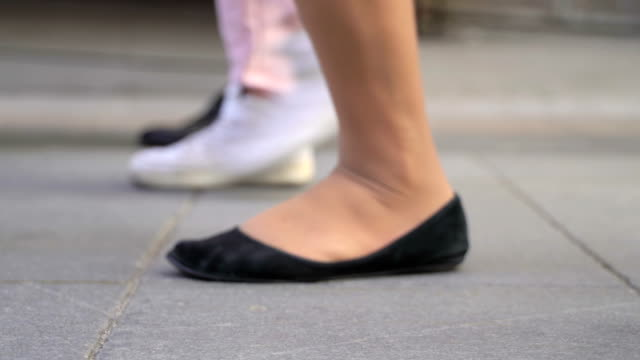 Concept crowd feet with shoes closeup. Anonymous people walking on the street. Unrecognizable crowd of people walking during commute. Low angle view. Concept of shoes as mirror reflection of character traits of human video