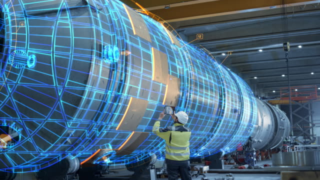 vídeos de stock e filmes b-roll de ar concept: industrial engineer uses augmented reality digital tablet to scan large metal construction, special effects show visualization / digitalization of oil, gas and fuel transport pipeline. - tecnologia