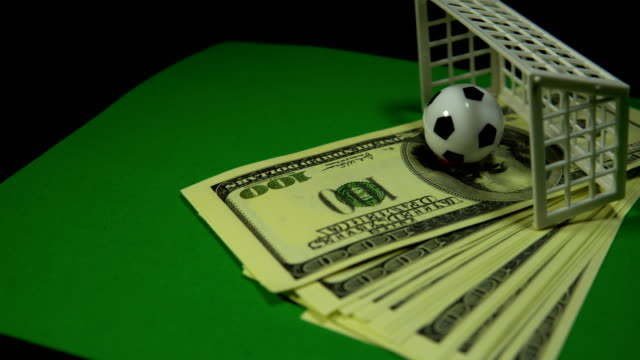 Concept money and sports, betting on football.