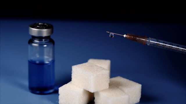 Concept of diabetes. Vial, sugar cubes and syringe of insulin video