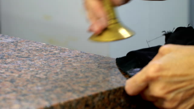 Concept of factory production genuine leather bags. Desktop work. Applying glue to the lining video