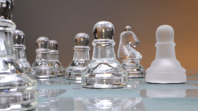 concept of the game and the development of the intelligentsia, glass chess arranged and ready for the game