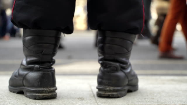 Concept power and people, police and demonstrators. Demonstrators through police boots video