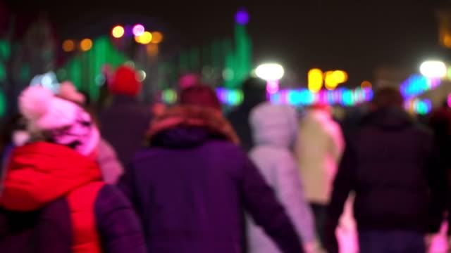 Concept winter sport. Night Skating Rink. Falling Snow. Christmas Star in Blur video