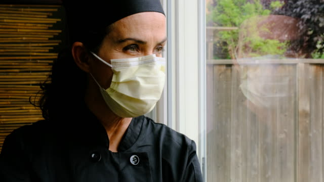 concerned female chef restaurant owner because her business is down because covid-19 - chef triste video stock e b–roll