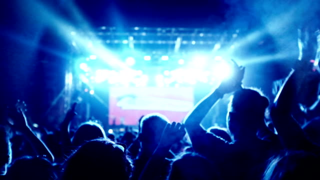 Concert crowd Concert crowd cheering at popular music concert. rock music stock videos & royalty-free footage