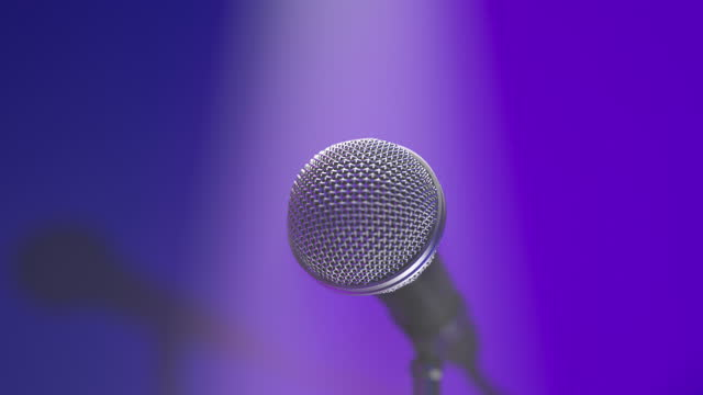 Concert microphone on the music hall stage in the stage lights and spotlight