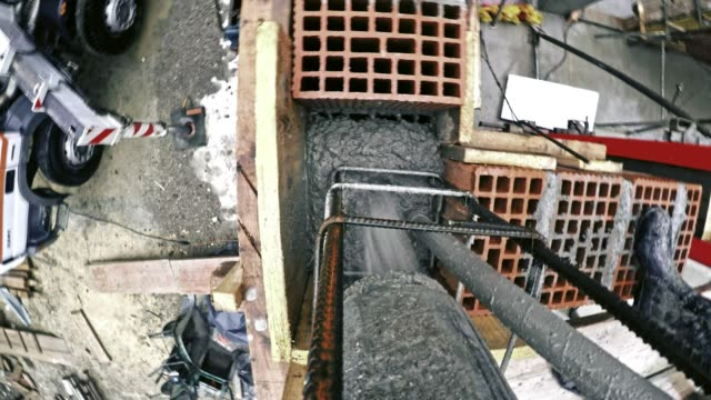 POV Concrete being poured into the vertical reinforcement to make a concrete column
