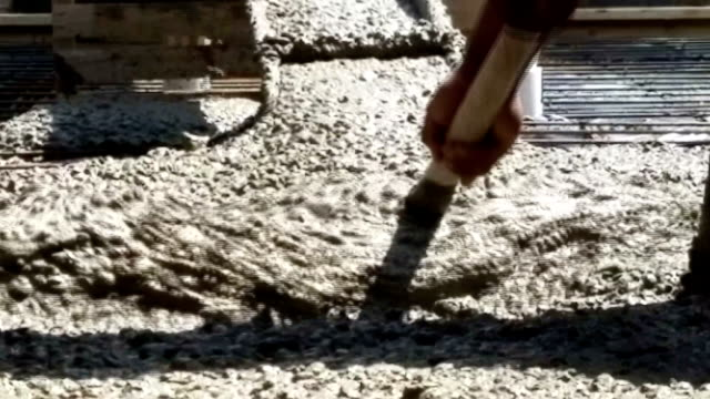 Concrete being poured onto prepared construction foundation. video