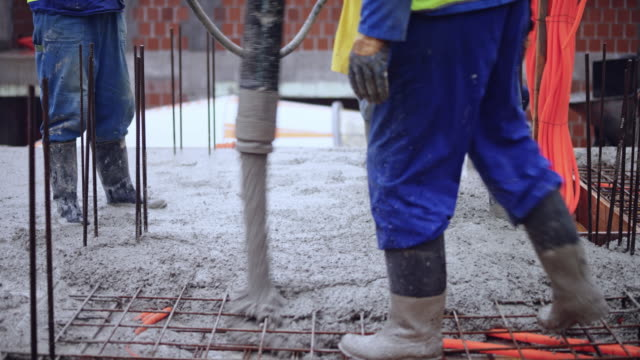 LD Concrete being poured onto the rebar layout for the floor of the building
