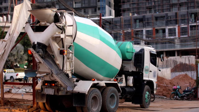 concrete mixer truck construction site work concrete mixer truck on construction site work dump truck stock videos & royalty-free footage