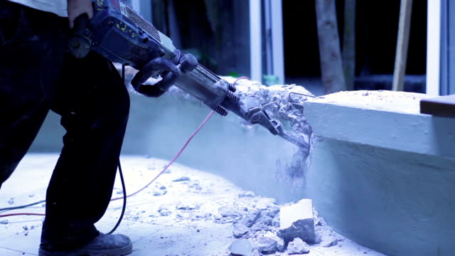 concrete ruined with a electric jackhammer video