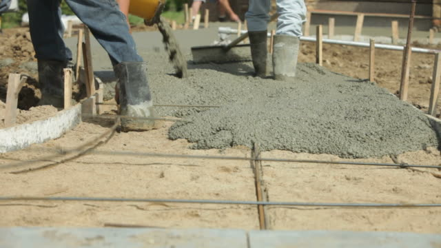 Concrete Sidewalk Installation with Mixer Trough and Workers video