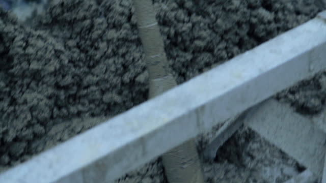 Concrete Worker Mixing Wet Concrete video