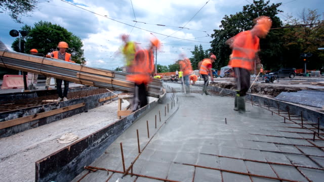 concrete works for road maintenance construction with many workers and mixer timelapse hyperlapse - upływ czasu filmów i materiałów b-roll