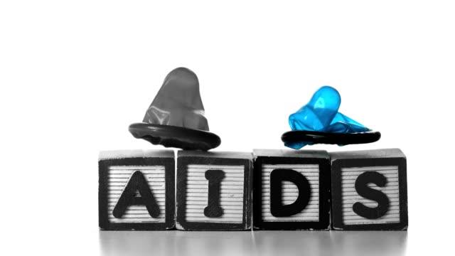 Condoms falling on blocks spelling AIDS video