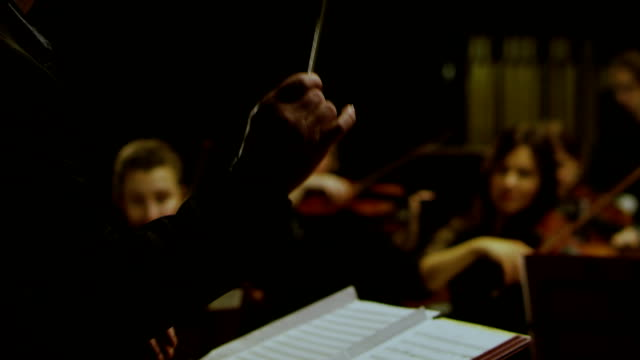 A conductor is conducting with a baton