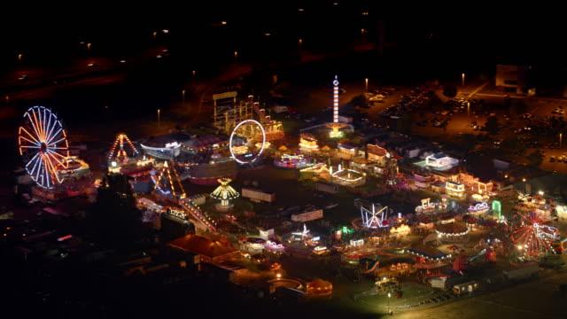 aerial coney island nöjespark på natten - fritidsanläggning bildbanksvideor och videomaterial från bakom kulisserna