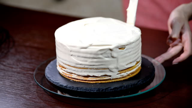 Confectioner prepares Layer Cake. Cooking the cake video