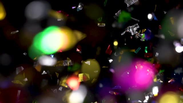 Confetti falling on black background