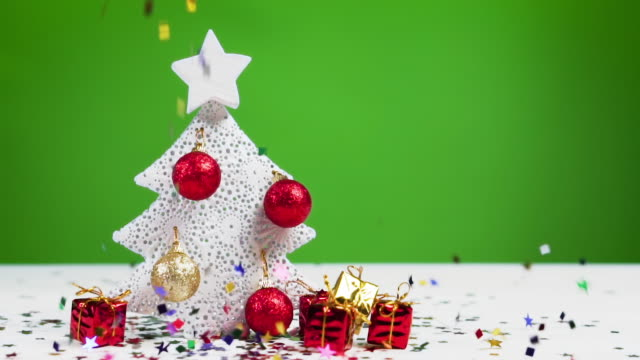 Confetti falls on a Christmas tree, slow motion. Xmas and New Year concept. Confetti falls on a Christmas tree, slow motion. Xmas and New Year concept. christmas stocking stock videos & royalty-free footage