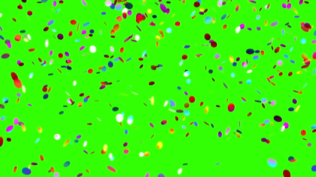 vídeos de stock e filmes b-roll de confetti falls on a green background - confetis