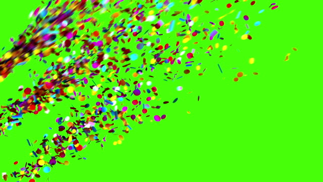 vídeos de stock e filmes b-roll de confetti party popper explosions on a green background - confetis