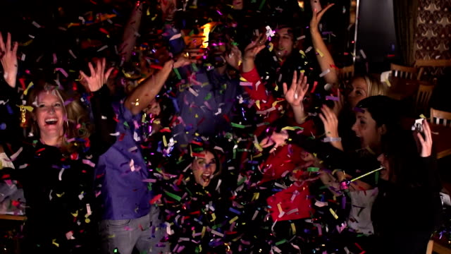 confetti young adults colleague party bar - montage - office party stock videos and b-roll footage